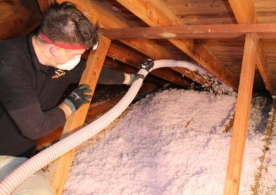 A man doing insulation
